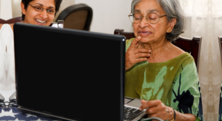 Old woman is using the laptop