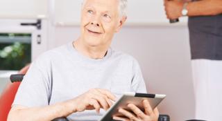 Old man is using ipad